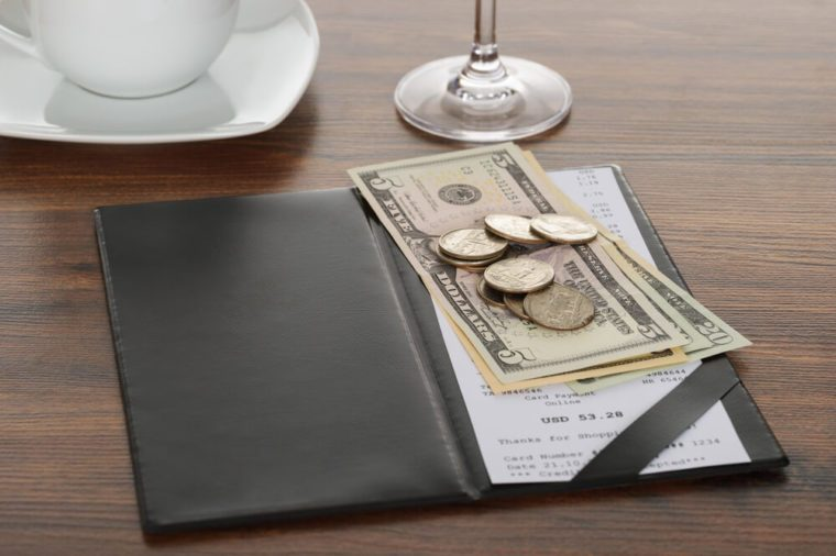 Close-up Of Bill With American Dollars On Wooden Table