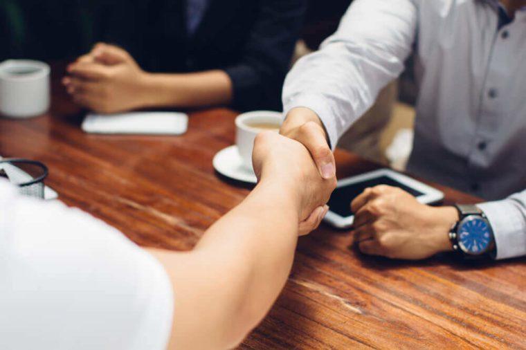 Close up portrait of businessmen shaking hands