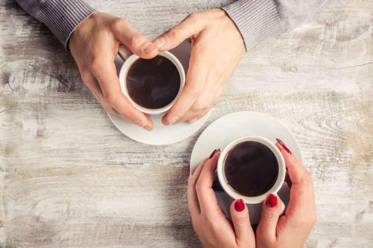 Hot coffee in the hands of a loved one.