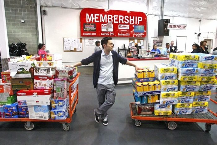 David Lee holds on to his carts while shopping at a Costco Wholesale store, in Portland, Ore. The Commerce Department said Wednesday, May 9, 2012, that wholesale stockpiles increased 0.3 percent in March, just one-third of the 0.9 percent rise in February. Sales in March were up 0.5 percent, about half the 1.1 percent sales gain in February