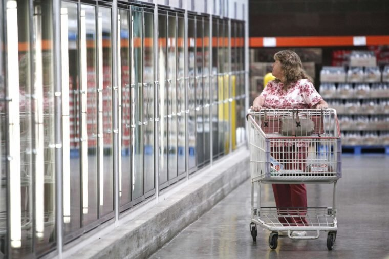 A shopper looks for grocery food items at Costco in Auburn Hills, Mich