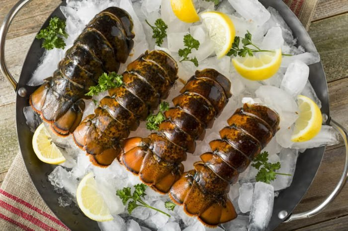 Raw Organic Fresh Lobster Tails with Lemon and Herb