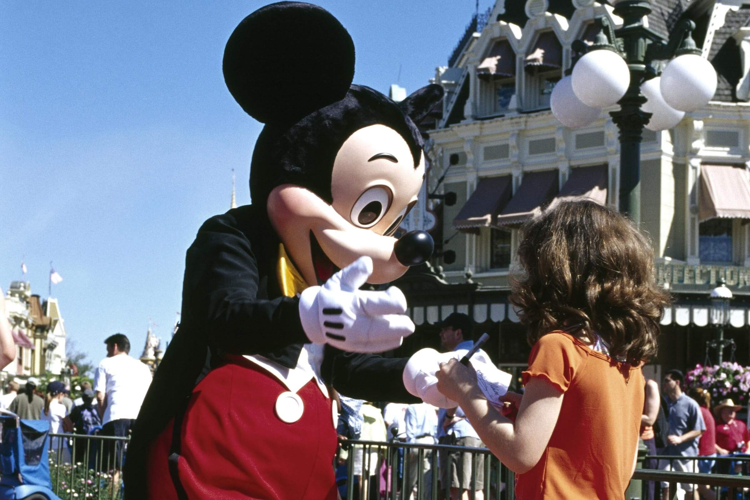 Mickey Mouse giving a girl his autograph, Disneyworld, Disney World, Orlando, Florida, USA