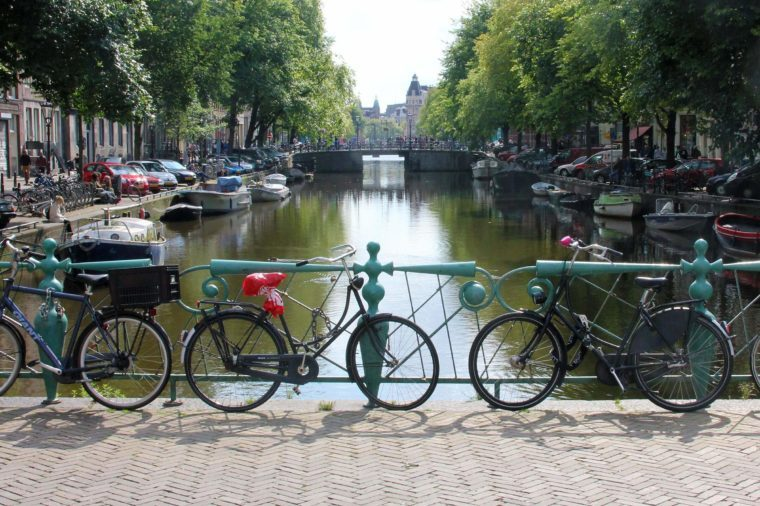 Bikes by a canal in Amsterdam, The Netherlands