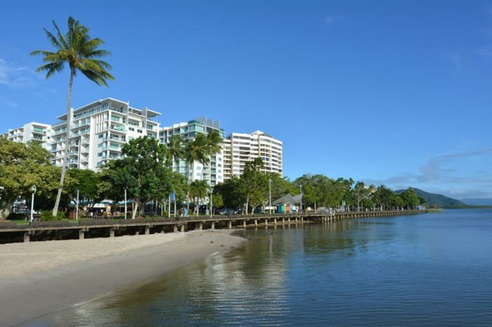 Cairns waterfront skyline in Queensland Australia at high tide.