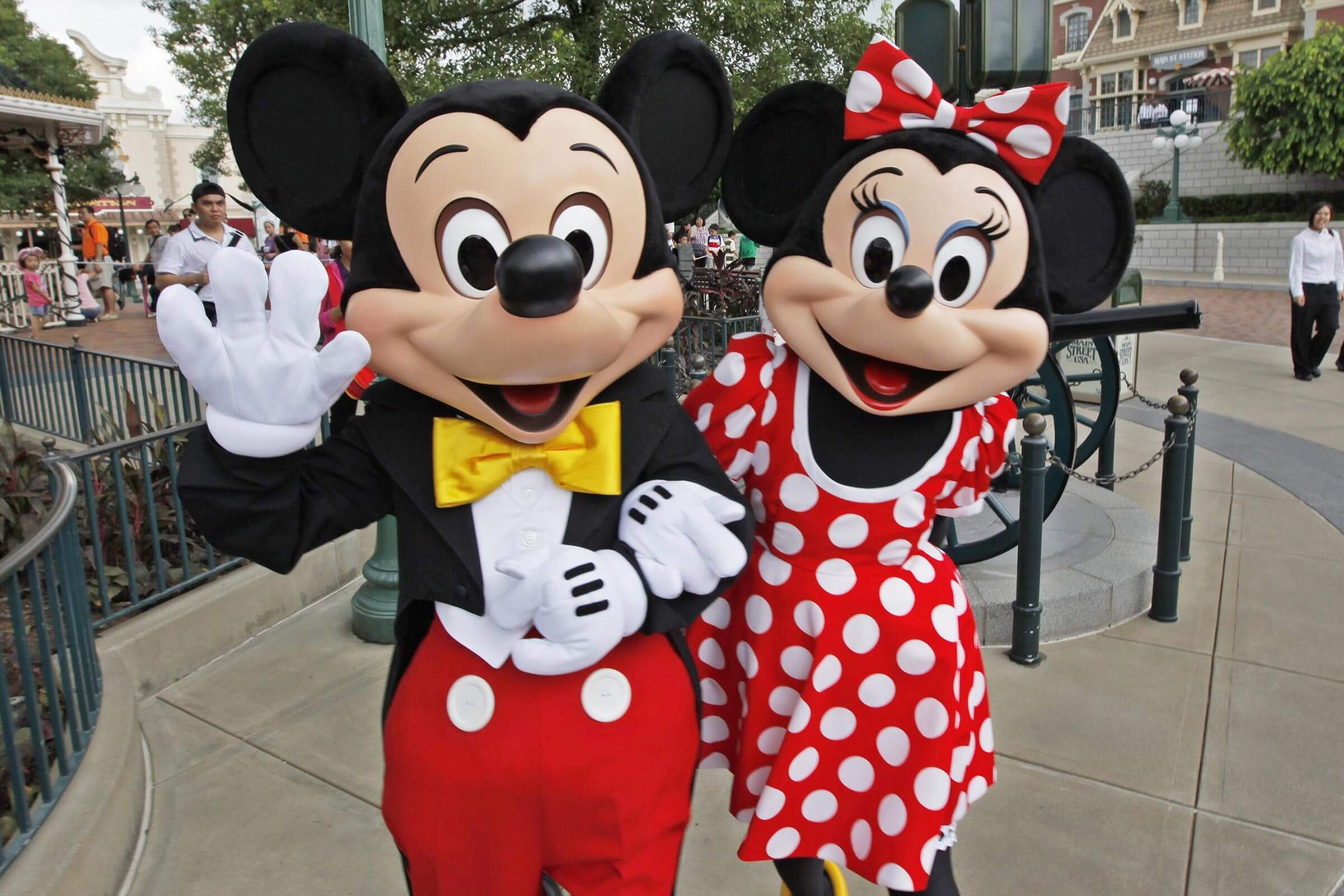 An Actor Clad As Cartoon Characters Mickey Mouse ( L) and Minnie Mouse Gesture at Hong Kong Disneyland Resort in Hong Kong China 12 September 2010 on the Day to Mark the 5th Anniversary Celebration Benefited From the Fast Economic Growth the Number of Visitors Expected to 5 Million in 2009-10 From 4 57 Million in 2008-09 Hong Kong Disneyland Resort Managing Director Andrew Kam Said to the Press Hong Kong Disneyland a Joint Venture Between the Us Walt Disney Co and Hong Kong Government China Hong Kong