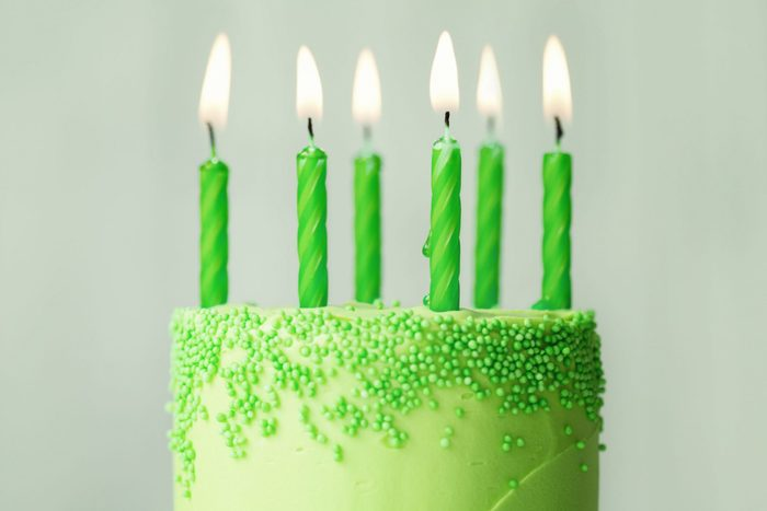 Green birthday cake with green candles. st patricks day fun facts.