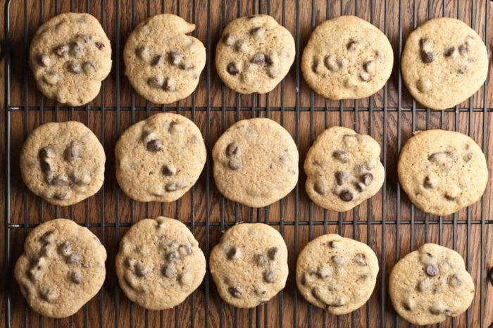 Cool top view shot of a dozen freshly baked homemade chocolate chip cookies on a cooling rack