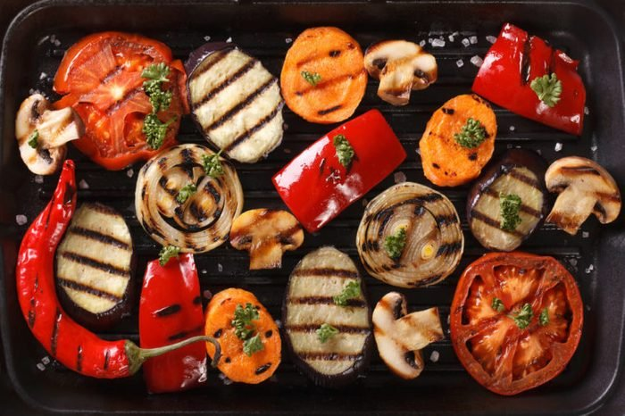 Background of grilled vegetables on a grill close up. horizontal view from above