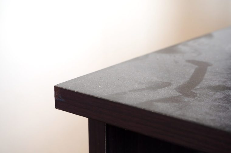 Close up of dust on wooden table