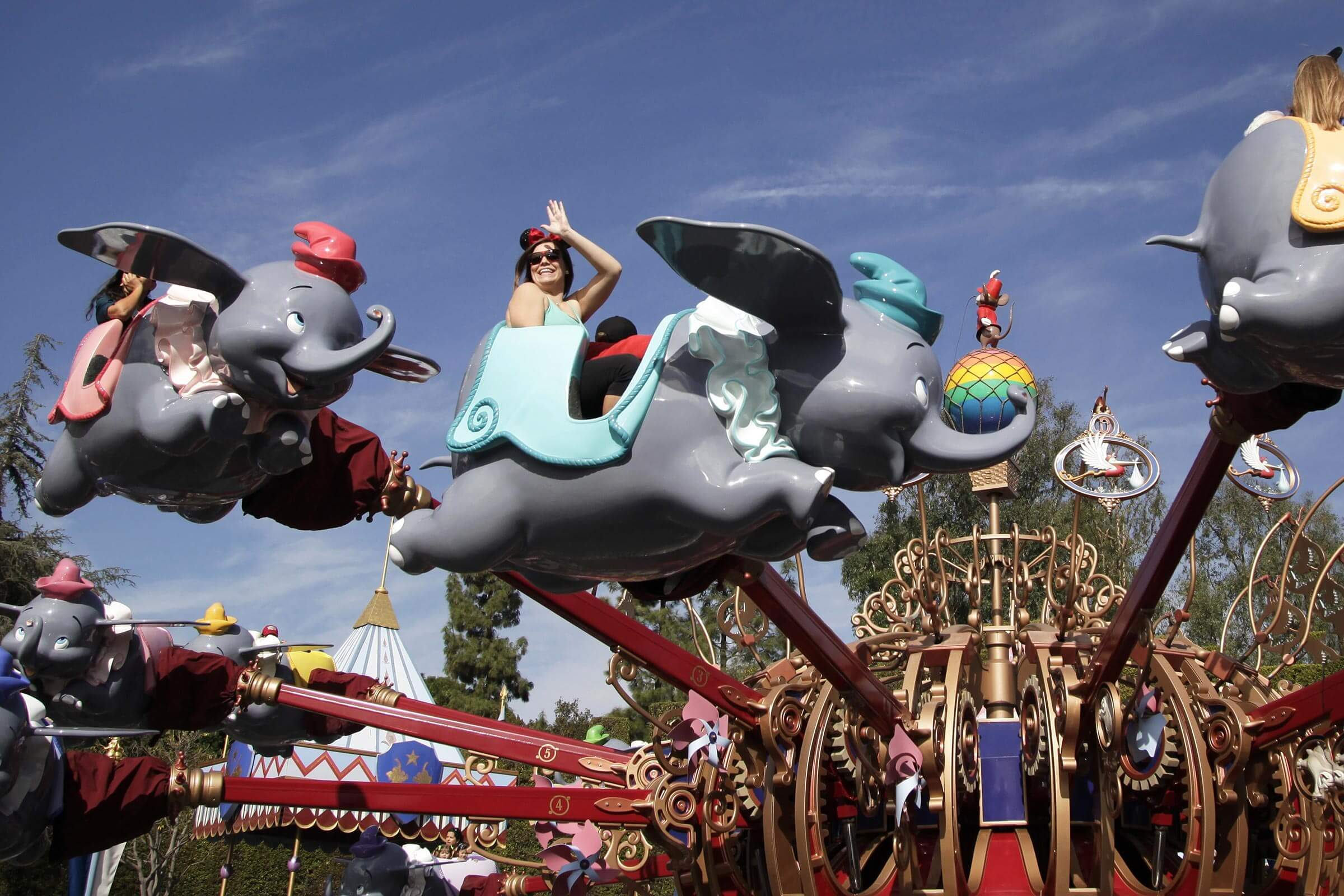 Visitors ride the Dumbo the Flying Elephant ride at Disneyland in Anaheim, Calif. Disney reports quarterly financial results