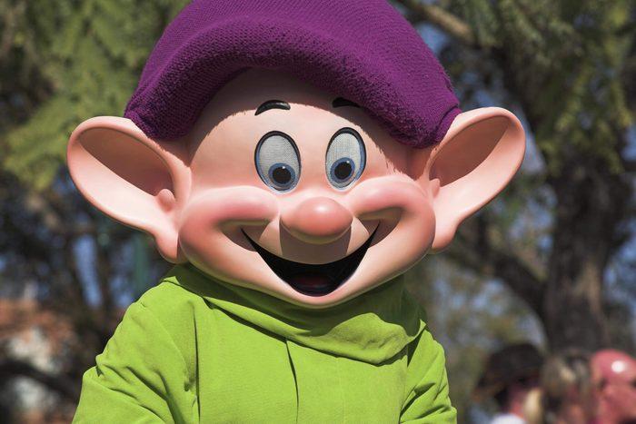 Walt Disney World Resort. Disney MGM Studios. Dopey, a dwarf from Cinderella during the Stars and Motor Cars Parade. Orlando Florida USA