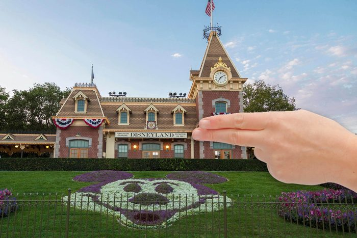 Disneyland Railroad Station, front Mickey mouse made out of flowers, Disneyland Resort, Anaheim, California, USAPointing