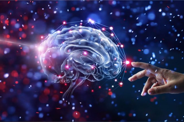 Hand touching brain and network connection on glitter bright lights colorful background