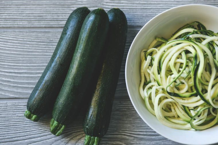 Zucchini noodles with zucchini over a table
