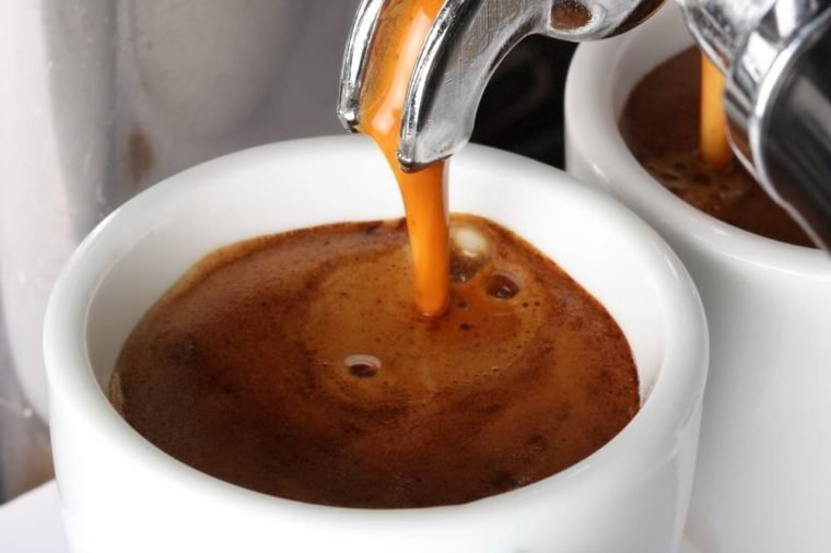Espresso pouring into a cup