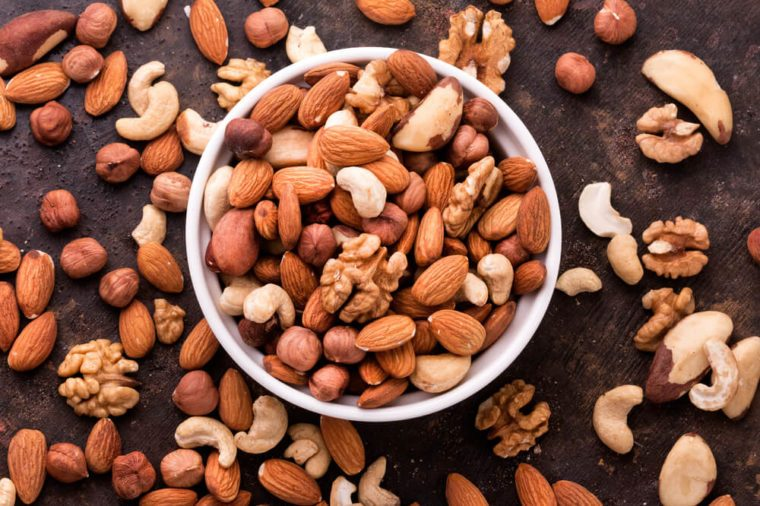 Mixed Nuts on dark background. Healthy food and snack. Top view.