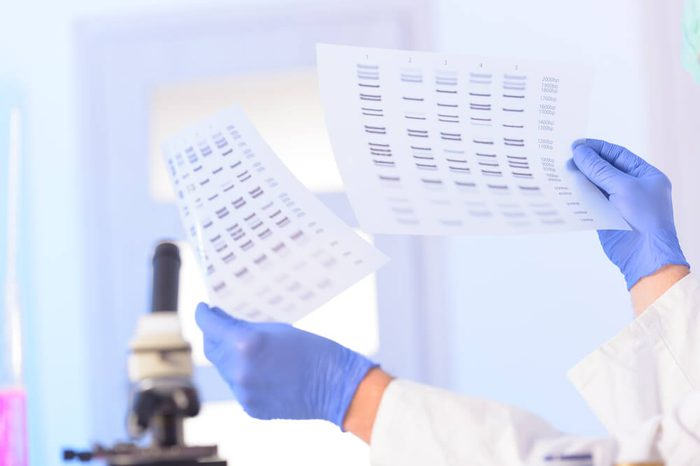 Scientist analizing DNA sequence for identity