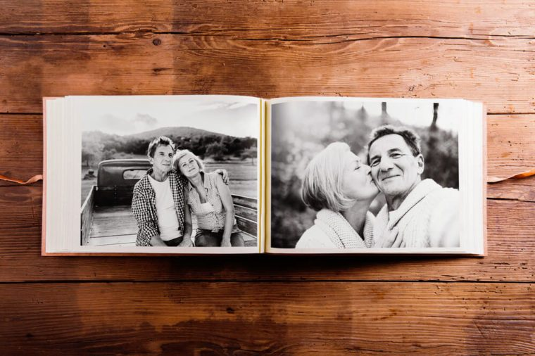Photo album with black-and-white pictures of senior couple.