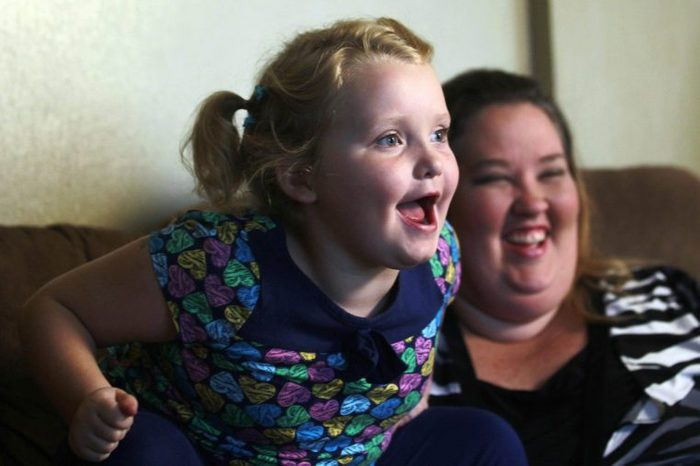 """Alana Honey Boo Boo Thompson, June Shannon Seven-year-old beauty pageant regular and reality show star Alana """"Honey Boo Boo"""" Thompson speaks during an interview as her mother June Shannon looks on in her home in McIntyre, Ga. The round-cheeked second-grader, who previously appeared on the TLC show """"Toddlers & Tiaras,"""" has a penchant for outrageous catchphrases as seen on her reality TV show, """"Here Comes Honey Boo Boo"""