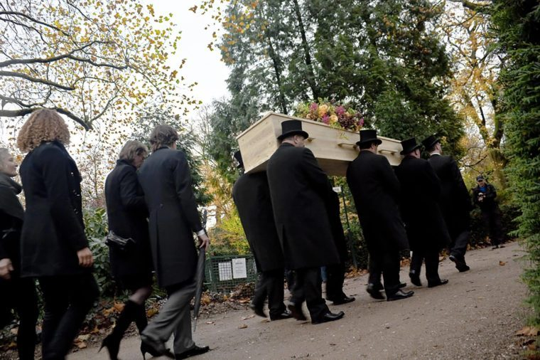 AMSTERDAM, THE NETHERLANDS - NOV 6: Mourners pay their respects at the funeral of Dutch author Harry Mulisch, November 6, 2010, Amsterdam, The Netherlands