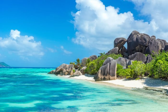 Anse Source d'Argent - granite rocks at beautiful beach on tropical island La Digue in Seychelles