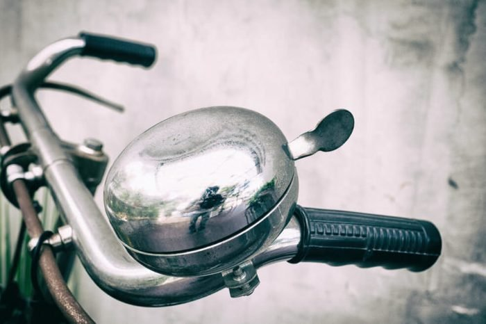 Bicycle ringing bell on the hands