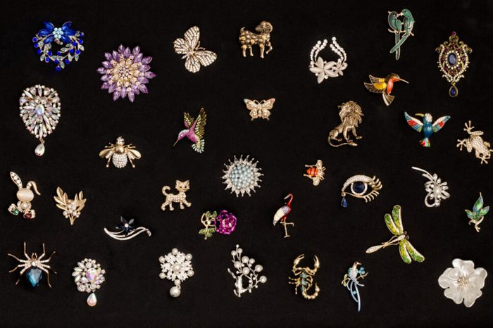 Pattern of brooches on a black background
