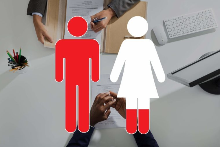 overhead view of hands on opposites sides of a desk with man and woman symbols overlay