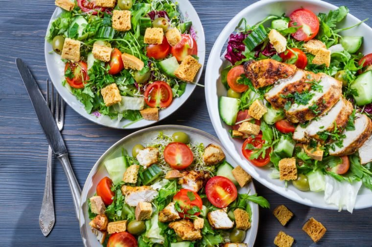 Healthy salads made of hot chicken and fresh