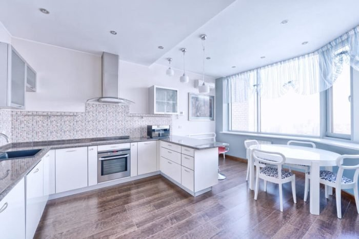 Interior design of a modern white kitchen in a new house.