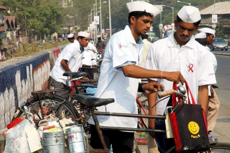 Dabbawallas Prepair the Delivery of Lunch Boxes in Bombay On Friday 01 December 2006 the Lunch Boxes Delivered by the Dabbawalas On the World Aids Day Today Will Have an Additional Element - a Pouch Containing the Red Ribbon a Booklet and Stickers to Raise Aids Awareness a Dabbawala is a Person in the Indian City of Bombay Whose Job is to Carry and Deliver Freshly Made Food From Home in Lunch Boxes to Office Workers More Than 175 000 Or 200 000 Lunches Get Moved Every Day by an Estimated 4 500 to 5 000 Dabbawalas