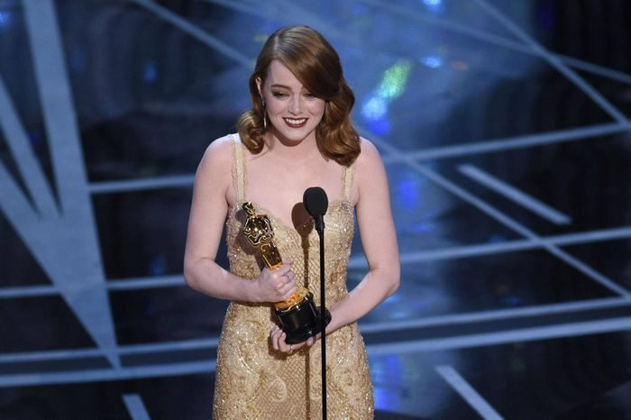"""Emma Stone accepts the award for best actress in a leading role for """"La La Land"""" at the Oscars, at the Dolby Theatre in Los Angeles"""