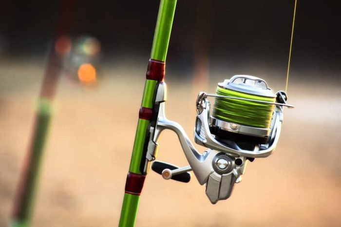 fishing rods with spinning and reel of a fisherman for surfcasting in beach shore