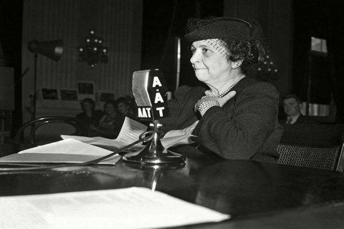"""Frances Perkins Secretary of labor Frances Perkins testifies, before the house committee on interstate migration, advocating extension of the benefits of certain social legislation to the """"Okies"""" and """"Arkies,"""" migrant farm workers she said the migrants should be placed under the wage-hour law, social security act and other legislation now covering other workers"""