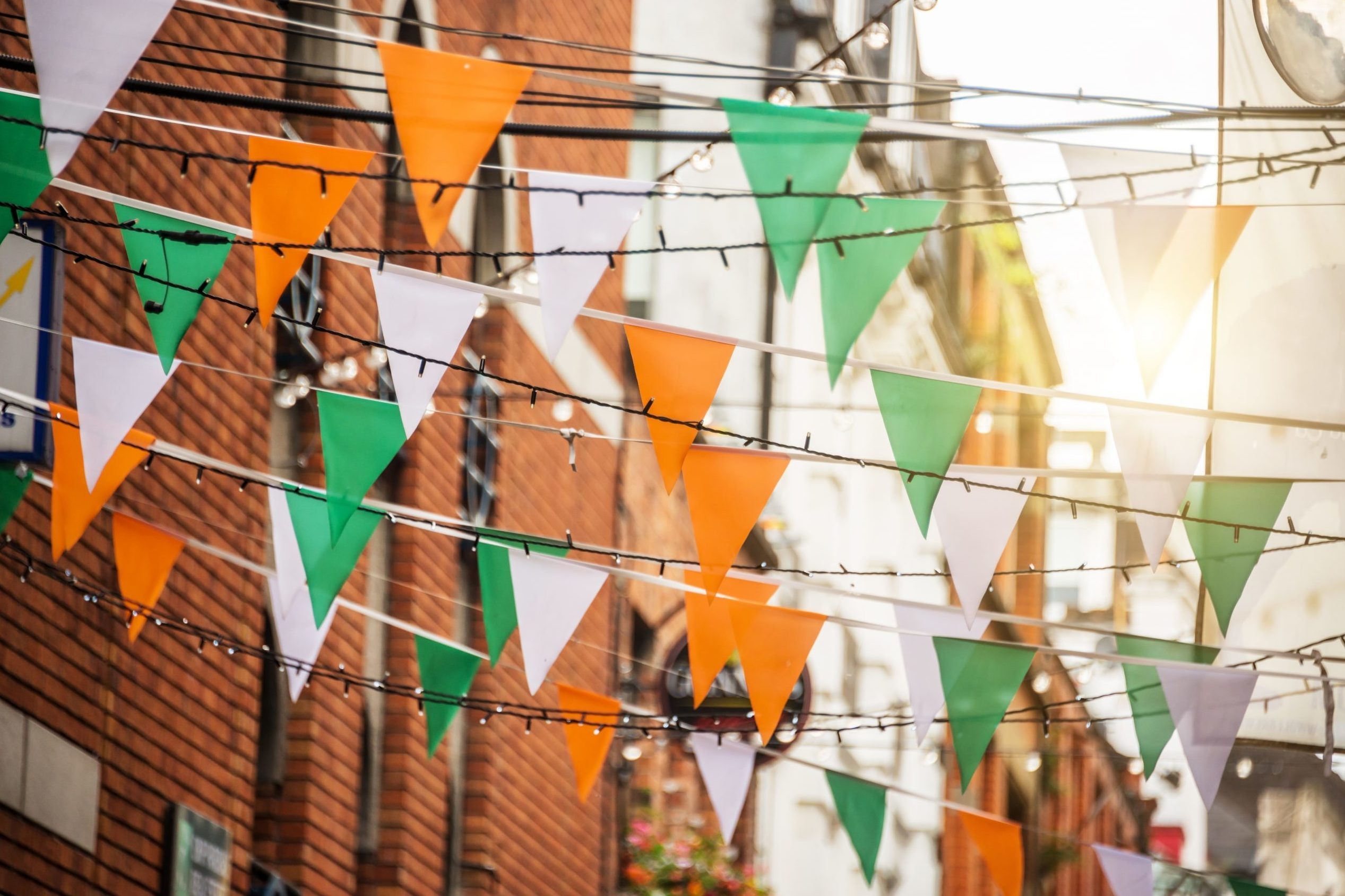 Garland with irish flag colors in a street of Dublin, Ireland - Saint Patrick day celebration concept. St. Patrick's Day fun facts.