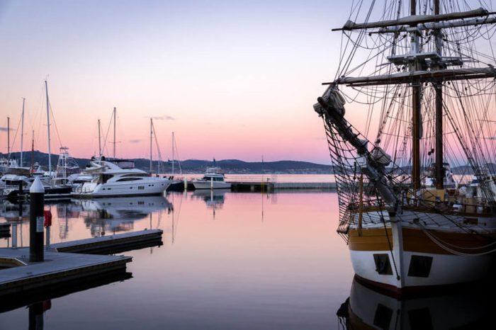 Sail boat at sunset in the port of Hobart, Tasmania