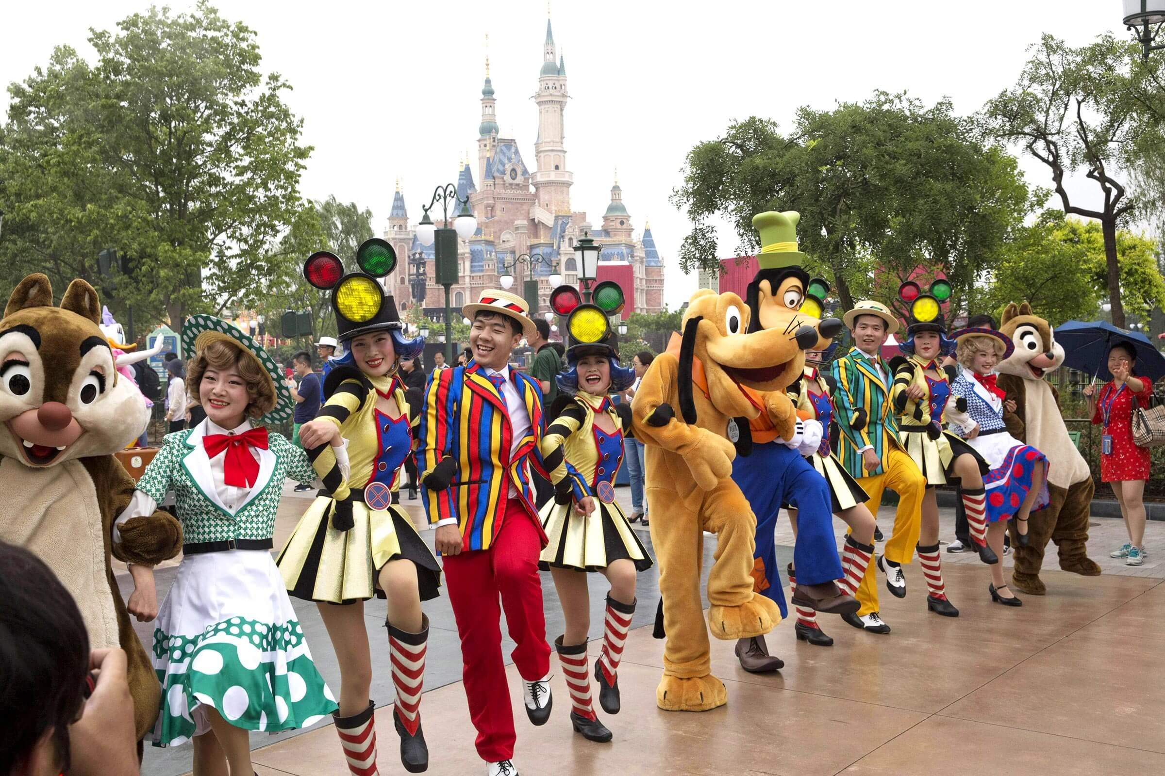 "Performers take part in a parade at the Disney Resort in Shanghai, China, on the eve of its grand opening. The debut of Shanghai Disneyland offers Walt Disney Co. ""incredible potential"" for boosting its brand in the world's most populous market, Disney's chief executive said Wednesday ahead of Thursday's grand opening for the $5.5 billion park"