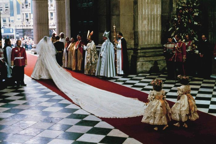 Prince Charles, Princess Diana With a 25-foot (7.6 meter) sweeping train, The Princess of Wales, former Lady Diana Spencer, leaves St. Paul's Cathedral arm in arm with Prince Charles at the end of their wedding ceremony in London