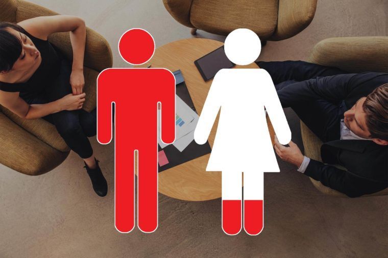 overhead view of business discussion with man and woman symbols overlay