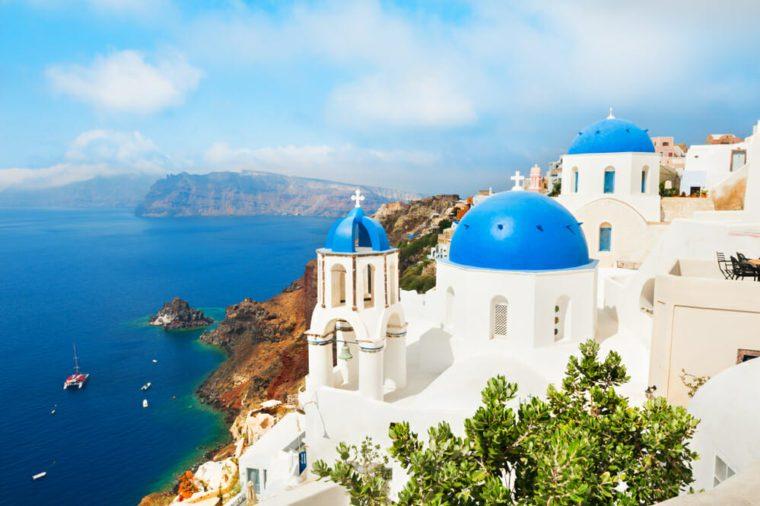Santorini island, Greece. White church with blue domes against the blue sea