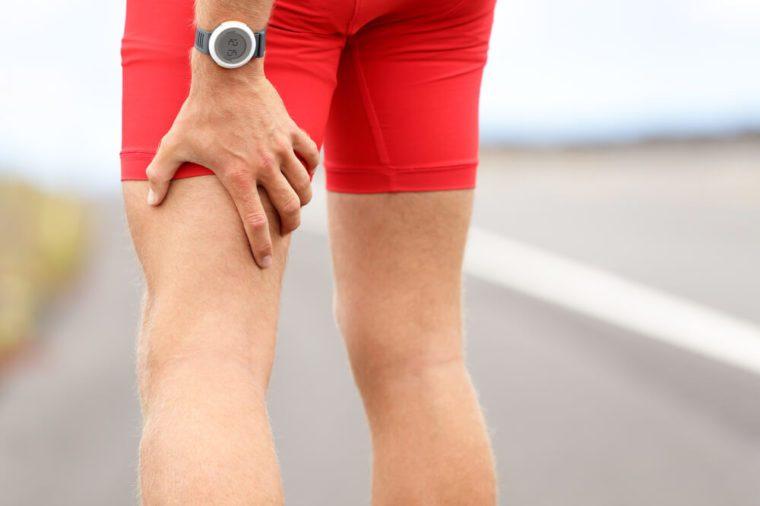 7b259bf5fc Hamstring sprain or cramps. Running sports injury with male triathlete  runner.