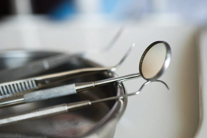 Metallic dentist tools close up in a dentist clinic.