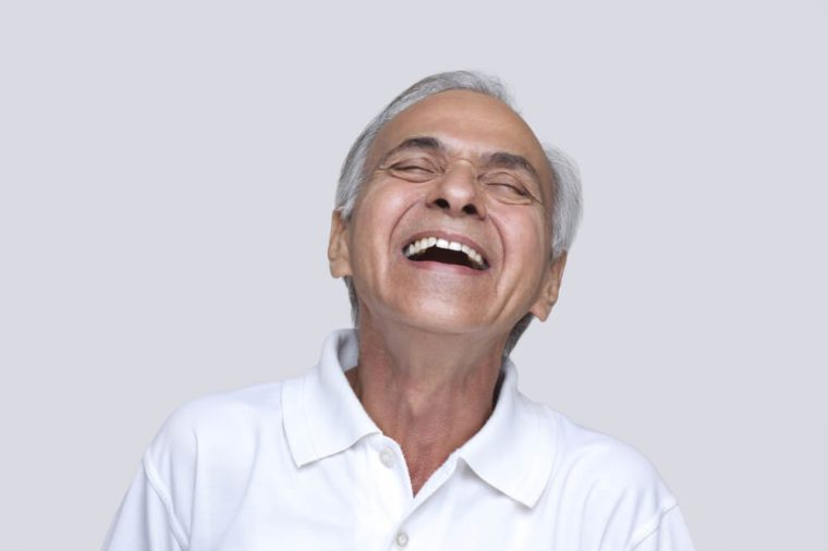 Excited man laughing with eyes closed