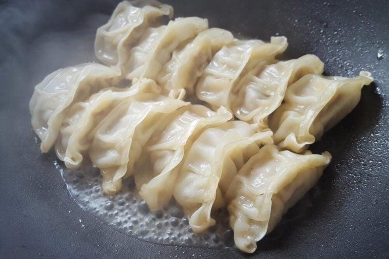 Close up fresh boiled gyoza dumplings with hot steams