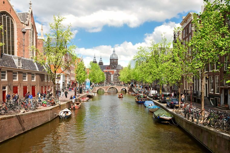 Church of St Nicholas, old town canal at spring day, Amsterdam, Netherlands