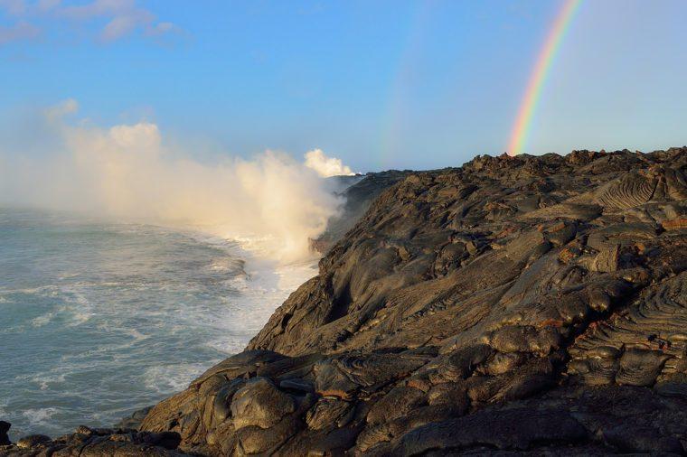 Hawaii Big Island Kilauea volcano floating lava into ocean rainbow