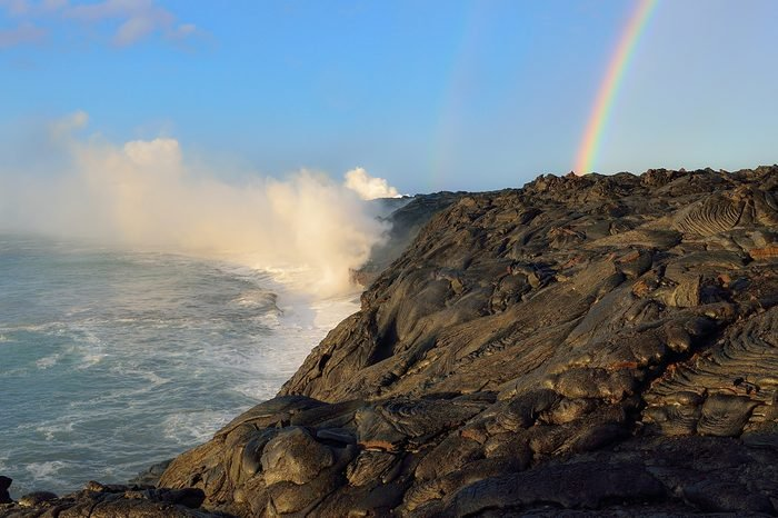 Hawaii Big Island Kilauea volcano floating lava into ocean rainbow
