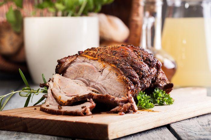 Roasted shoulder of pork on a cutting board