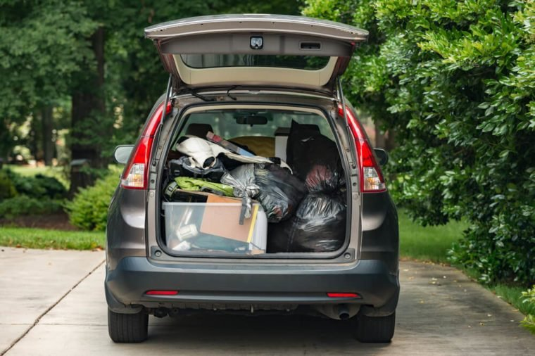 SUV packed quickly with belongings thrown in for move home from college